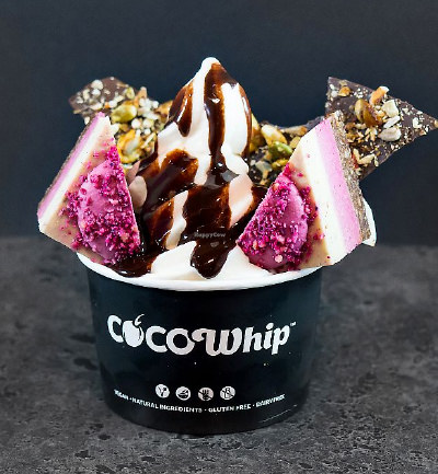 An image of a Cocowhip creation with raw cherry ripe slice and vegan chocolate sauce