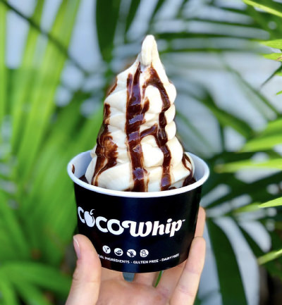 An image of a takeaway Cocowhip with vegan chocolate sauce