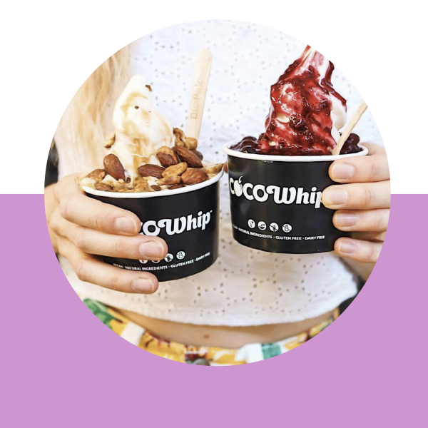 An image of Cocowhip creations with nuts and berry compote