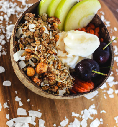 An image of a granola bowl with BSKT Veganola, fruit and Cocowhip